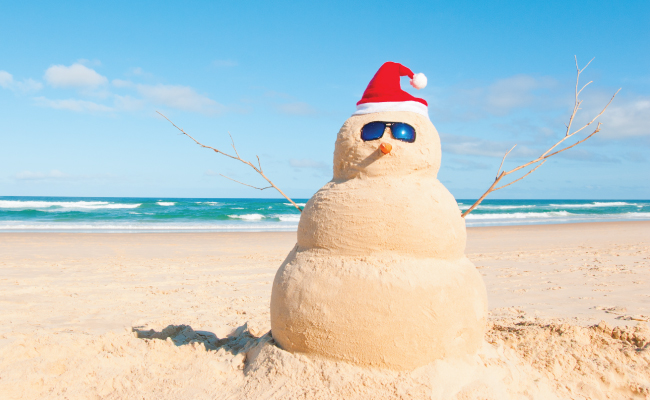 Snowman made out of sand on the beach
