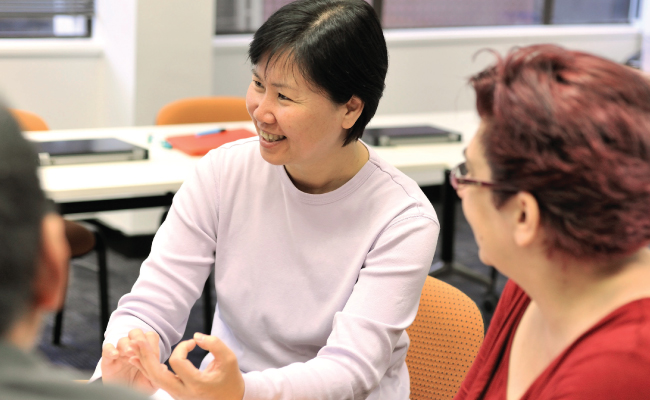 Asian lady talking in group