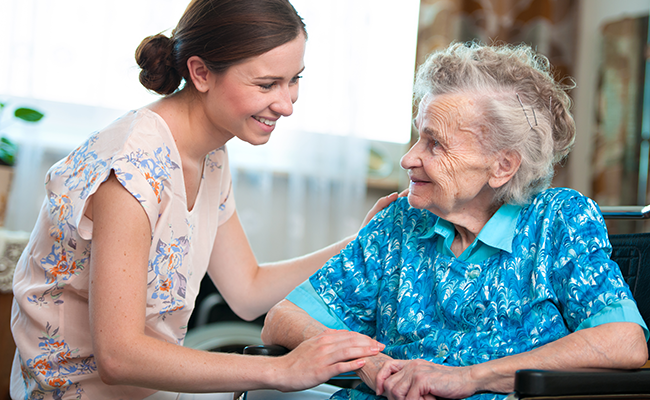 Aged care nurse with an elderly lady