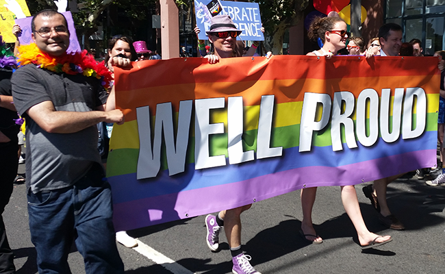 Well Proud people marching at Midsumma Pride March