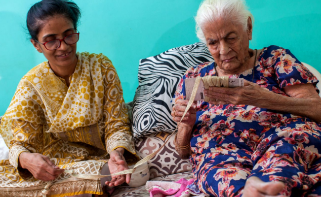 Two elder ladies doing crafts
