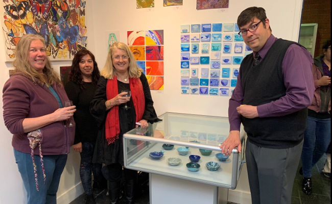 Wellways staff and participant posing with blue bowls art