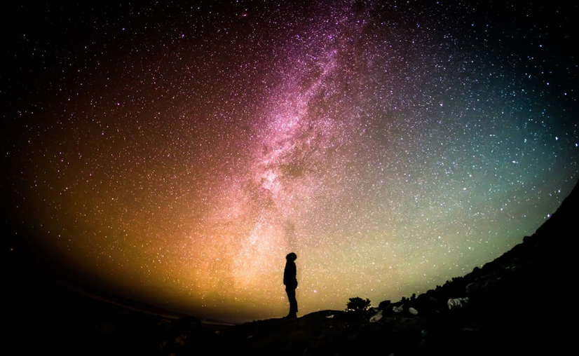 Person staring at the sky full of stars